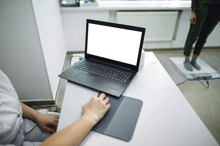 Female doctor colnsult with laptop in clinic office. Consult women before podologist therapy. Medical concept