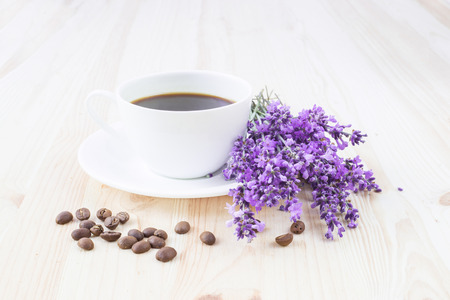 Aroma coffee cup with lavender on saucer and beans. photo