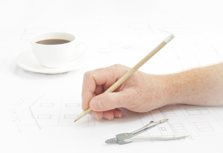 Architectural background. Human hand with pencil over blueprints with sketches of projects. photo