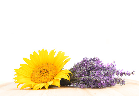 Lavender and sunflower on the tabel and white background. photo