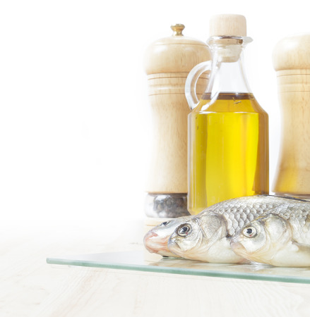 fish oil: Fresh fish with spices and oil isolated over white  Stock Photo