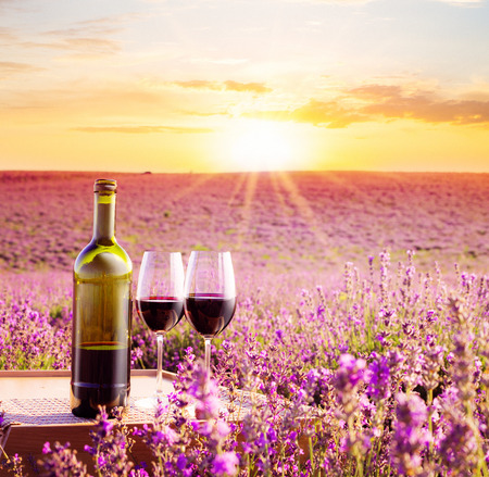 Bottle of wine against lavender landscape