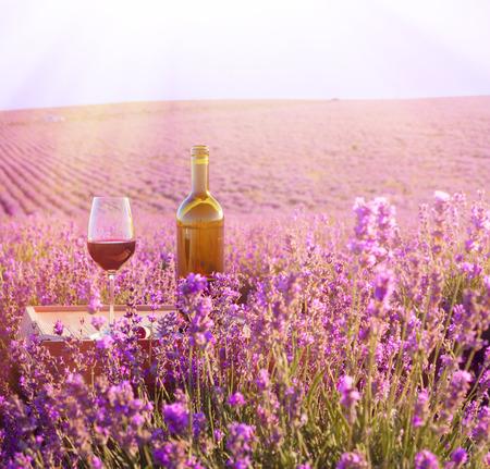 Bottle of wine against lavender landscape  photo