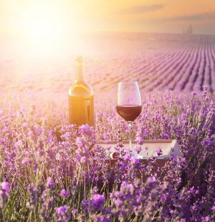 Bottle of wine against lavender landscape