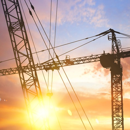 Industrial crane over sunset background. Vector illustration. Vector
