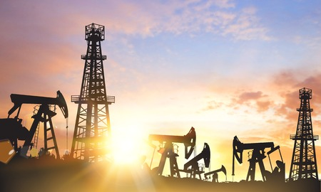 gas supply: Oil pumps and derricks over sunset background. Vector illustration.