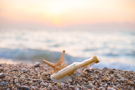 message in a bottle: Summer background photo. Message in glass bottle.
