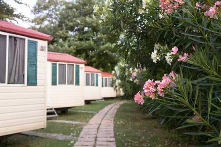 mobile home: Wood chalet in garden. Chalet house in the camp. Stock Photo