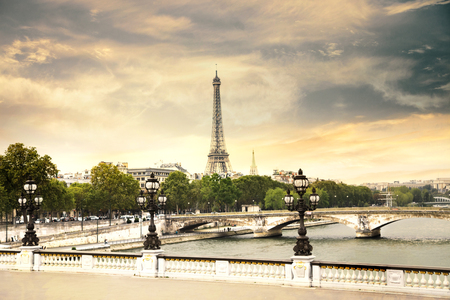 alexander: The Eiffel Tower and Pont Alexandre III at evening in Paris, France.
