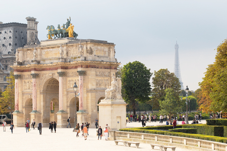 quadriga: Arch Triumph Carousel with Eiffel tower on background. Triumphal arch in Paris, located in the Carrousel Square on the site of the former Tuileries Palace.