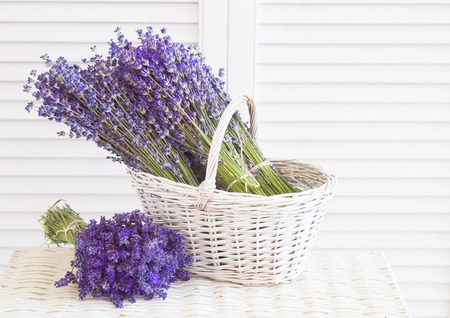Basket with a lavender and white wooden shutters.