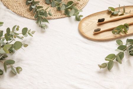 Natural materials style with leaves of eucalyptus on a light fabric