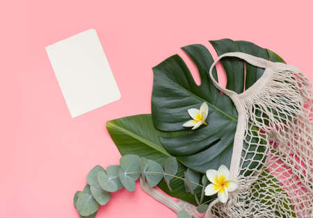 Tropical mockup, palm leaves, paper card and notebook on pink background