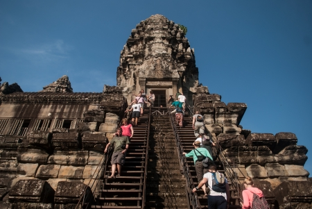 steers: Tourists climb the steers in Angkor Wat Editorial