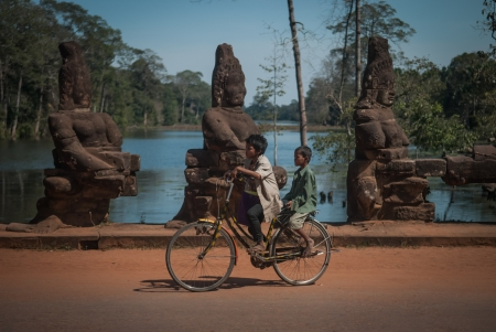 Two boys on a bicycle at the entrance of Angkor