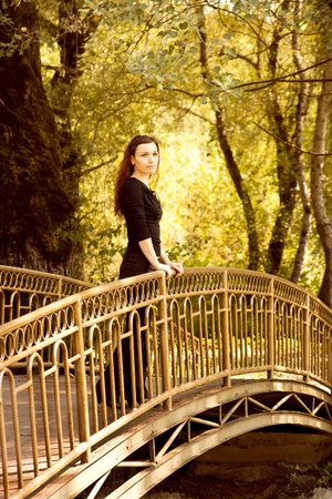 light brown eyes: Woman on the bridge