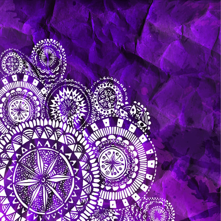 White round ornaments on purple rumpled paper background.