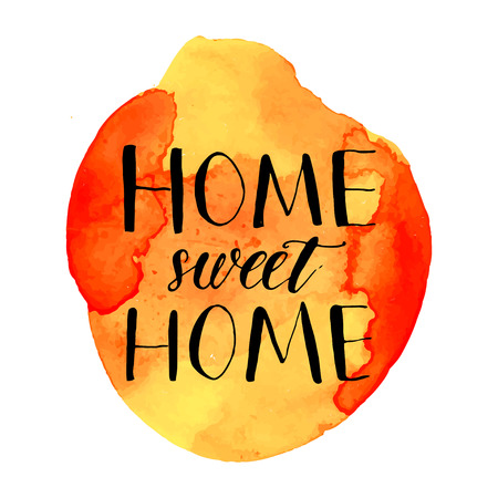 homely: Home sweet home phrase handwritten on orange watercolor paint blot.