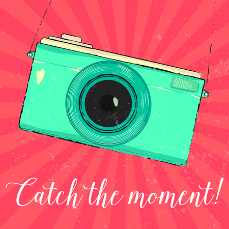 'catch the moment': Vintage turquoise photo camera.