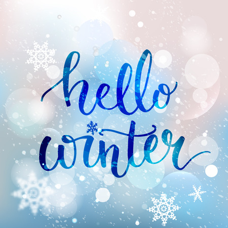 Hello winter text. Brush lettering at blue winter background with snowflakes and bokeh lights. Vector card design with custom calligraphy