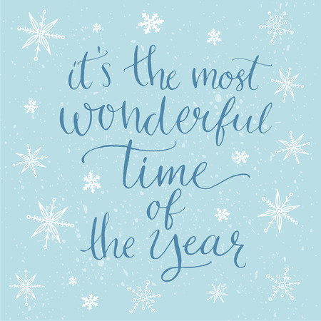 most: Winter inspirational quote for cards, posters and social media content. Its the most wonderful time of the year. Modern calligraphy at blue background with white snowflakes