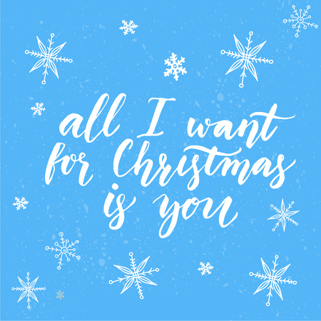 i want you: All I want for Christmas is you. Inspirational quote for Christmas cards and greetings. Modern calligraphy phrase on blue background with white snowflakes.