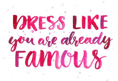 quotes: Dress like you are already famous. Inspirational quote about fashion and clothes. Pink watercolor brush lettering, custom calligraphy. Bright motivational slogan