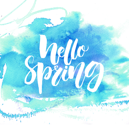 Hello spring calligraphy . White text on blue watercolor texture.