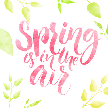 the air: Spring is in the air watercolor lettering in green leaves frame. Stock Photo