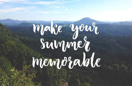 memorable: Make your summer memorable. Inspirational quote overlay on the photo of landscape with mountain and forest. Script brush lettering Stock Photo