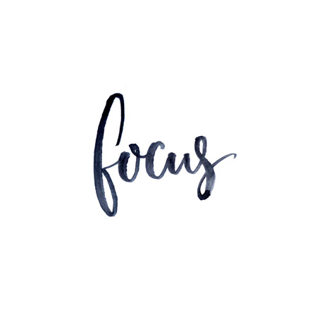 Focus. Minimalistic design about concentration and work. Ink and brush lettering isolated on white background Reklamní fotografie