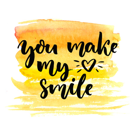 You make my heart smile. Brush calligraphy on yellow watercolor texture