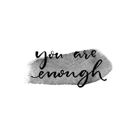 enough: You are enough. Inspiration saying handwritten on gray ink stroke.