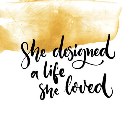 she: She designed a life she loved. Feminism quote lettering at golden paint stroke texture.
