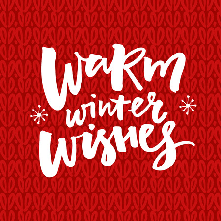 Warm winter wishes text on red knitted background. Christmas greeting card with brush lettering