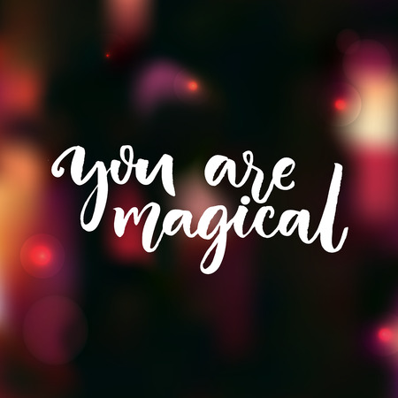 You are magical. Love confession saying. Valentines day card. Vector modern calligraphy at dark red blurred background Illustration