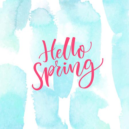 say hello: Hello Spring. Modern calligraphy text at blue watercolor texture. Inspirational saying. Spring season greetings.