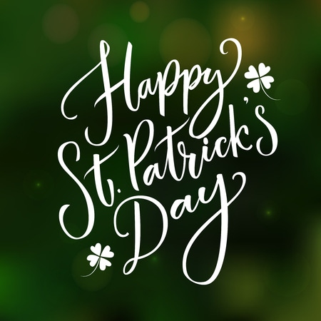 Happy St. Particks day - greeting card with typography at dark green blurred background