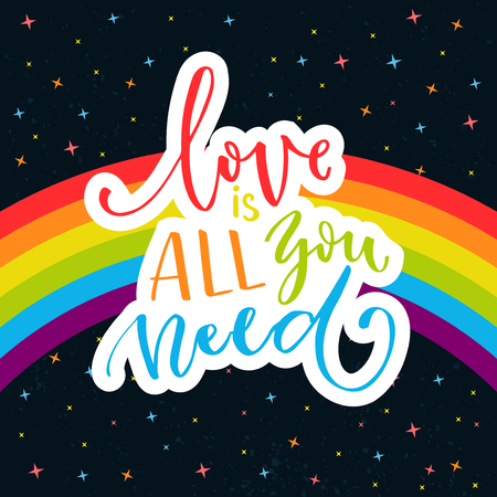 catchword: Love is all you need. Romantic quote on rainbow parade flag at dark sky with stars.