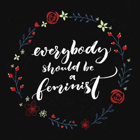 Todo el mundo debería ser feminista. Cita del feminismo, caligrafía del cepillo en fondo negro con la guirnalda floral