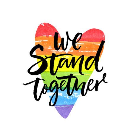 Stoimy razem. Inspirujący slogan LGBT han dwritten na serduszku z tęczową flagą.