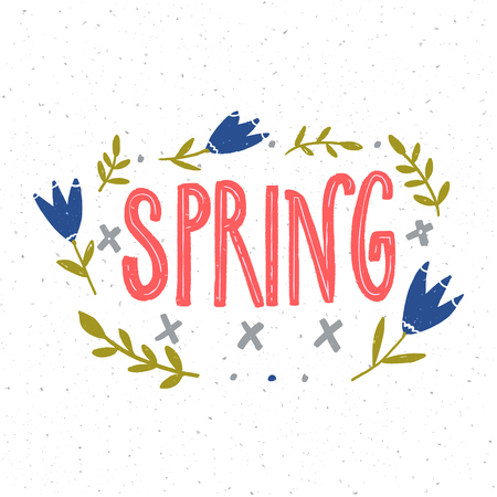Spring hand lettering word decorated with blue flowers and green branches on white background