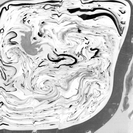 Abstract monochrome marble texture. Paper and mix of flowing ink. Stock Photo