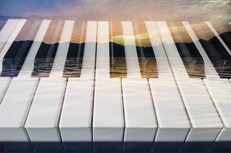 Classical music  double exposure of piano keys and sea landscape light