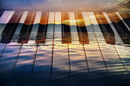 Classical music  photo double exposure of piano keys and sunset of a sea landscape creative