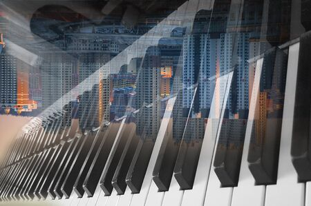 background art photo double exposure of piano keyboard and city Stock fotó