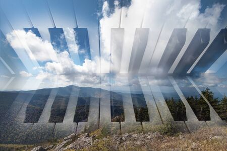 art background photo double exposure of piano keyboard and mountain landscape