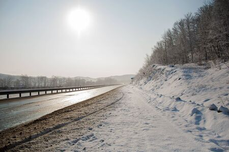 art photo of the road to the sun after a snowfall