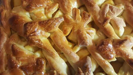 homemade freshly baked apple pie close-up with dough decoration