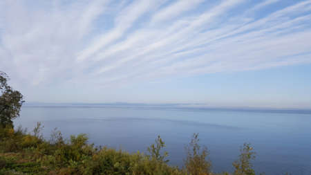 art photo of the morning sky and the Sea of Japan with clouds and a coast in Vladivostok Stock fotó